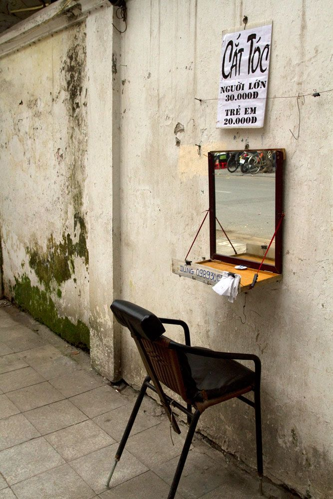 - Hairdresser on the street, Hanoi