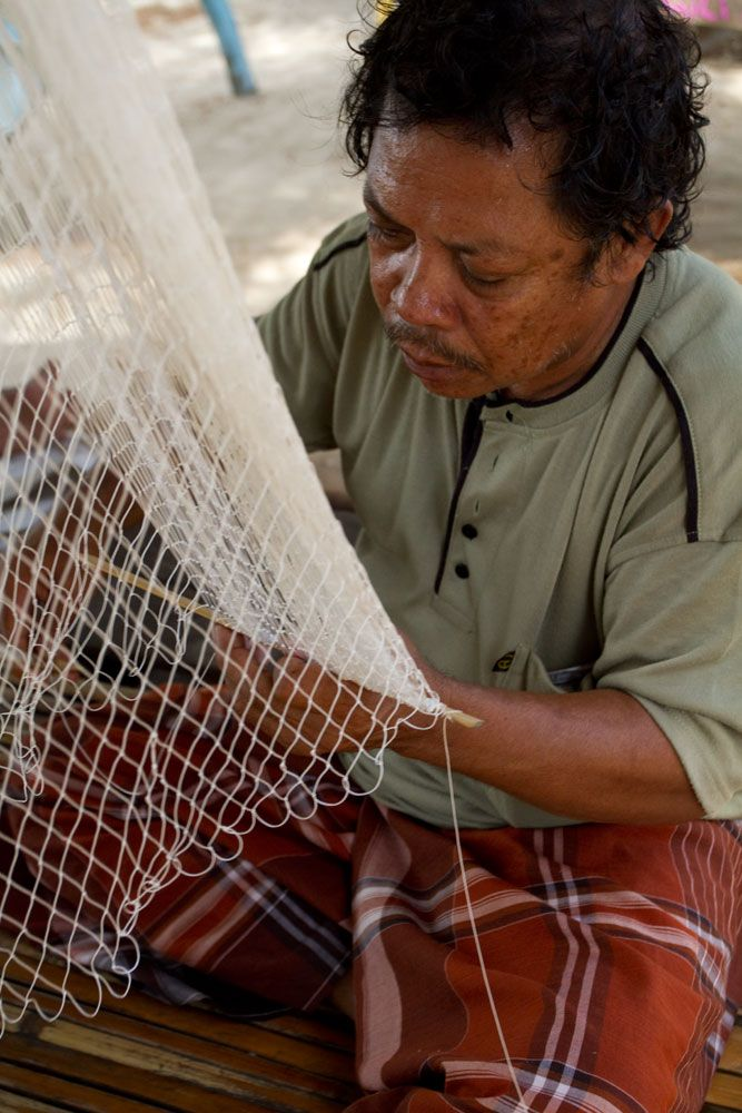 - Fisherman making fishing net
